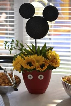 Mickey Mouse flower centerpiece.  See more Mickey Mouse birthday party and kids birthday party ideas at www.one-stop-party-ideas.com