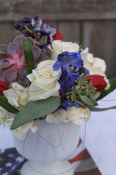 red,white,and blue centerpiece in milk glass container.  Andrea K. Grist Floral Designs