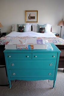 Turquoise chest replaces the usual end-of-the-bed trunk or tufted bench