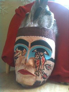 A beautiful native west coast traditiional carved mask by Qaamina Hunter, Nuu-Chal-Nulth, shows his love for the pacific wild salmon. Clayoquot Wilderness Resort. www.wildretreat.com