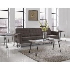 The Owen Coffee Table from Altra features a slim, attractive profile with retro-style hairpin metal legs. It's perfect for any sitting room, including the main living area, the den, a finished basement or even an office.