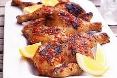 Portuguese Flat Chicken 1 Medium spatchcocked Chicken 4 large cloves of garlic 1 tablespoon of coarse salt 1 teaspoon Coarse ground black pepper Juice of two lemons Half cup of dry white wine Half cup olive oil Good quality ground red chili