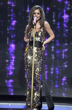 cheryl cole performing on stage in shimmering golden pailette dress