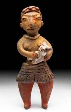 Preclasico altiplano central 1200-600 ac Tlatilco Mexico M Arq Nac Mexico figura femenina con perro