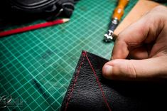 A leather working guide for beginners: In this tutorial I will show you how to make an iPhone sleeve out of an old leather bag without having to buy many tools. It's a starting point if you want to work with leather but you're not sure if you want to spend hundreds of dollars on tools and materials. Note: for in-depth hand sewing instructions, please check out my hand sewing tutorial. The end result is this simple iPhone case: Let's get started: DONE!