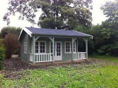 Mini cricket pavilion style log cabin
