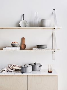 light wood + white marble + wood shelves + leather detail