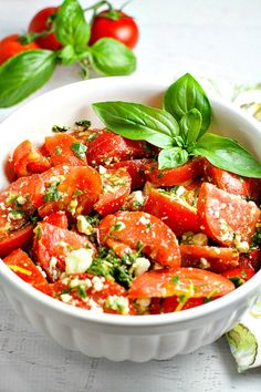 Colorful, healthy, and packed with flavor, this easy Tomato, Basil and Feta Summer Salad is the perfect side dish for any summer dinner, and even makes for a wonderful light lunch as well. Go ahead and customize it by adding in cucumber or even summer corn…the basil dressing goes well with everything!