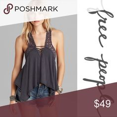 Free People Strappy Gray Eyelet Top ➖BRAND: Free People  ➖SIZE: XSmall  ➖STYLE: A V neck Strappy Eyelet Asymmetrical Hem Tank with a criss cross low back design.    ❌NO TRADE   246487 Free People Tops Blouses