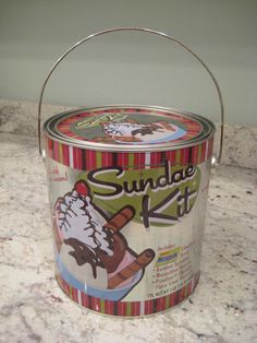 sundae fixings + paint can + tub of froyo or ice cream = cute christmas gift