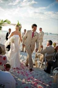 Beach ceremony bride groom flower petals