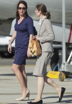 Catherine's private secretary Rebecca Deacon, and George's nanny Maria Borrallo clutching the kangaroo backpack.