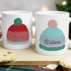 Woolly Hat Personalised Mug Set - £19.95. Keep them warm and toasty in the festive season with Pippins' adorable Woolly Hats Mug Set. This great gift is just perfect for cosy nights around a fire!  The pair of mugs make the perfect present for any special couple. Crafted from quality white ceramic, the mugs feature a fun and vibrant woolly hat design, one blue and pink and one red and blue, that can be personalised with a name of your choice on each mug.
