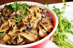 ~VEGAN MUSHROOM STROGANOFF~  THIS RECIPE IS :  Dairy Free, Vegan  SERVES 4 - 6  **INGREDIENTS**  8 oz. uncooked ribbon noodles~ 1 tablespoon olive oil~ 1 yellow onion, chopped~  3 tablespoons whole wheat flour, divided~  2 cups beefless beef broth or veggie broth~  1 tablespoon soy sauce~  1 teaspoon lemon juice~  1 teaspoon tomato paste~  1 1/2 pounds mushrooms (half portobello and half button mushrooms), cut into large 2-inch chunks~  1/2 teaspoon dried thyme~  1/2 teaspoon dried sage~ 1/2…