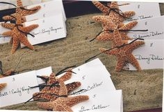These starfish escort cards in a sand display are a great way to carry the beach theme indoors at your reception.