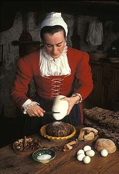 Reconstruction of a 17th century maid braking sugar from a sugar loaf