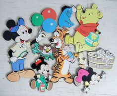 Charming set of vintage pressed cardboard Walt Disney Productions pin-up characters including Mickey Mouse, Pooh Bear, Tigger and more. 10 pieces.  Occasional, light vintage wear here and there on the edges. Pieces vary in size. Mickey Mouse is approximately 14-1/2 tall while the owl on a branch is 4 tall. Shortcut to the rest of my etsy shop is here: PeppermintBark.etsy.com --------------------------------- Im always happy to combine shipping on multiple purchases made at the same time ...