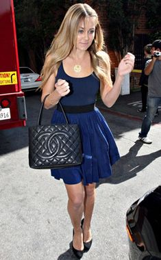 I like her dress and her bag of course. Not sure I could pull this off.