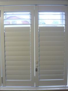 Rhino Shutters photographs of our elegant home security shutters. Metal security shutters with the style of plantation shutters American Shutters, Security Shutters, Roller Shutters, Elegant Homes, Blinds, Curtains, Living Room, Gallery, Image