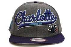 NEW ERA Charlotte Hornets Scripter 2 9Fifty Snapback    Grey / Blue / Teal / White    This 9FIFTY cap features an embroidered (raised) Charlotte Hornets script team namesake at front, a stitched New Era flag at wearer's left side, and a stitched team logo at wearer's right side. A snapback closure for an adjustable fit. Interior includes branded taping and a moisture absorbing sweatband.  New Era flag may vary in color with the image featured on site.    100% Wool.