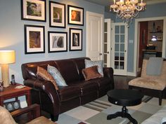 A grouping of six travel photographs, mixing horizontal and vertical prints, is an ideal focal point above the sofa.