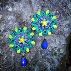 #earrings from my #Alphonsemucha #jewelry #collection #flower #glass #Swarovski #sexy #couture #unique #redcarpet #style #blue #green #chartreuse #purple #rainbow #yellow #gold #fashionista