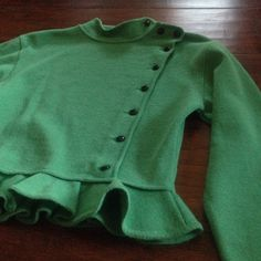 HP 2/5 + 4/17 Vintage Ungaro Ter Ruffle Sweater This chic vintage Emanuel Ungaro green button-up sweater is 100% wool and 100% adorable. Amazing vintage condition. Made in Italy. Fit is TTS. Color is best represented in photos 1 & 2. Emanuel Ungaro trained under Balenciaga until 1964, and started House of Ungaro (now owned by Salvatore Ferragamo) in Paris in 1965. Ungaro Ter, a women's knitwear line, was produced from 1988 to 1991. Sorry, no trades for this one! Vintage Sweaters