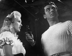 """Betty Grable and Victor Mature standing together during filming """"I WAKE UP SCREAMING"""" ,someone is holding a light meter between them Best Film Noir, Classic Movie Stars, American Singers, Hollywood, Actresses, Songs, Portrait, People, Movies"""