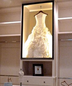 Wedding dress display case in the master closet.  Beautiful idea created by designers from Houston's ASID showcase 2014. #wedding