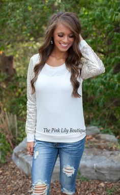 The Pink Lily Boutique - Sparkle In The Night White Blouse , $39.00 (http://thepinklilyboutique.com/sparkle-in-the-night-white-blouse/)