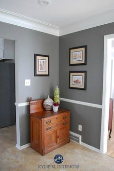 The 9 Best Benjamin Moore Paint Colors – Grays (Including Undertones) Benjamin Moore Chelsea Gray wtih chair rail, wood cabinet and home decor. Kylie M Interiors E-decor Dark Paint Colors, Kitchen Paint Colors, Room Paint Colors, Paint Colors For Living Room, Paint Colors For Home, Living Room Grey, House Colors, Grey Paint, Charcoal Paint