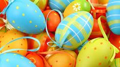 Beautiful egg ornaments are perfect adorning forsythia or dogwood branches in an urn to decorate for Easter.