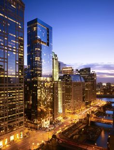 "Search condos for sale or rent near Chicago's Clark/Lake ""L"" station, the busiest in the entire city. For more information, contact Gold Coast Realty today! Chicago River, Condos For Sale, City Lights, Public Transport, Gold Coast, San Francisco Skyline, Skyscraper, Architects, Theatre"