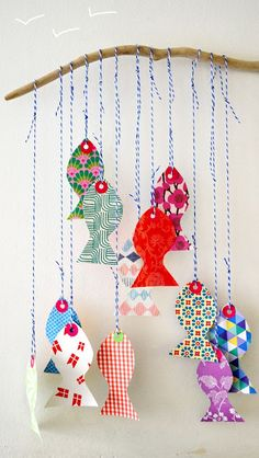 DIY Paper Fish. (nice for any season stars and trees with Christmas for example??)
