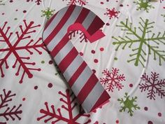 Candy Cane card made with construction paper and white tape.