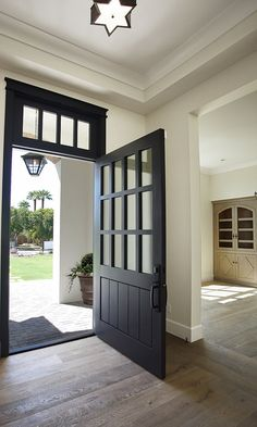 Exterior dutch door exterior dutch doors dutch front entry doors dutch front door black a exterior . Front Door Entrance, Door Entryway, Front Entry, Black Entry Doors, Black Garage Doors, Front Door Design, Foyer Decorating, House Doors, Exterior Doors