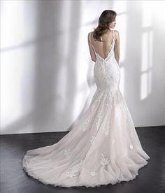As part of Pronovias, the St. Patrick Collection is remarkably diverse. These are both simple and elegant dresses with luxurious materials such as silk and chiffon, tulle and organza beautifully combined with the finest embroidery, crystals & lace appliqués. Price range: £900- £1600
