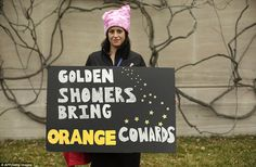 In Washington DC a protester takes a swipe at the new president's golden shower scandal with this placard
