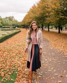 Julia Engel shares her daily look on Gal Meets Glam. Julia is wearing a Max Mara coat, Co Sweater, Gabriela Hearst skirt, and more.
