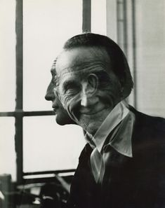 Portrait of Marcel Duchamp. By Victor Obsatz. 1953, gelatin silver Print. In March 1953, the Greenwich Village gallery owner Michael Freilich (RoKo Gallery) asked 28 year-old Victor Obsatz to photograph Marcel Duchamp in his apartment on West 14th Street. The resulting double-exposure print pleased Duchamp very much, as he chose it especially for the front and back covers of Robert Lebelââ. The work has since become one of the most popular and sought-after images of the artist.