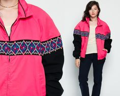 Vintage 80s 90s jacket in hot pink with a tribal print. Zips up the front. Unisex.  Every item we sell is authentic vintage and one-of-a-kind! You will receive the EXACT item shown in the photos. For reference, model is 59 and measures 34-24-37. DETAILS  Best fits: Labeled Large (Note: We only have ONE in stock. If more than one size is listed it is because this item will work on a range of sizes. Check measurements for exact fit.) Condition: Great Vintage Material: Cotton/poly shell, Po...