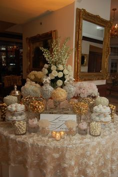 Ivory and gold candy buffet. Would add a little bit of pale blue though