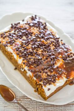 Pumpkin Caramel Poke Cake - Easy and the BEST PUMPKIN CAKE ever!! Two kinds of CARAMEL sauce, TOFFEE bits, CHOCOLATE CHIPS, whipped topping and more!! A total WINNER you must make!!