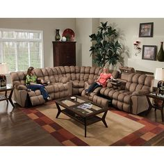 This gorgeous, comfortable, 3-piece sectional sofa features a reclining sofa with a drop-down table, a reclining loveseat with a console and a corner wedge. Brown, padded suede microfiber upholstery provides comfort and style.