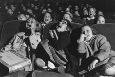 .   peachical:   greeneyes55:   In a movie theater USA 1958 Photo: Wayne Miller   this makes me happy     awww  i dont want to grow up