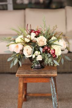 Centerpiece with Tiramisu spray roses, Juliet garden roses, Quicksand roses, White Majolica spray roses, Mondial roses, grevillea, millet, green wheat, seeded eucalyptus, Carolina sapphire and Redwood, by Floral Verde LLC in Cincinnati, OH.