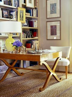In this study, designer Jan Showers doubled down on visual impact by pairing a patterned rug with a bookshelf filled with booksandpicture frames and dotted with artwork. Photo byJeff McNamara.