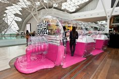 Side view of the epic Models Own bottle shaped store at Westfield's White City, London