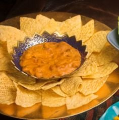Spicy Cheese and Meat Dip - This slow cooker appetizer recipe is fabulous with chips. Your game day guests will love it.