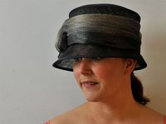 Reminiscent of a cloche hat, this black small brimmed hat features a multitonal band around the crown which is finished to the right with a beautiful flower detai. Cloche Hat, Brim Hat, The Crown, The Borrowers, Beautiful Flowers, Hats, Black, Products, Fashion